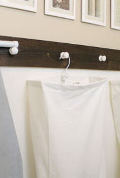 diy laundry room organization, laundry rooms, organizing, storage ideas, I hung knobs on the wall and placed the hanging laundry bags on them Also found a perfect spot to hang the ironing board out of the way