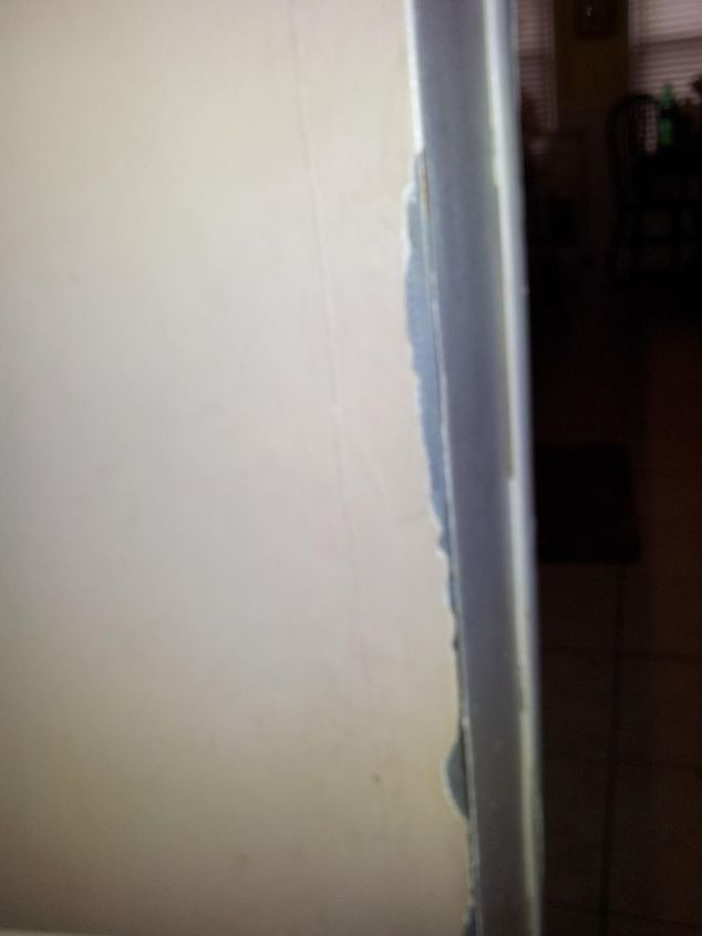 The worse part of the kitchen doorway (the line you see at the back of the opening is the finished wainscotting in the kitchen that wraps around the edge).