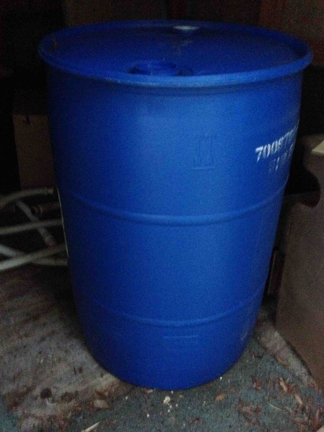 rain barrel, gardening, go green, My husband brought me a couple of these barrels home from where he works I washed them out really good and using a rain barrel kit I drilled all the holes using the hole saws that came with the kit