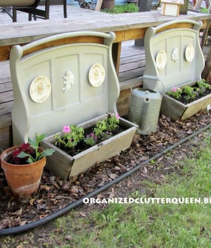 I just painted them gray, set them behind cedar planters and decorated them with cherubs and plates.
