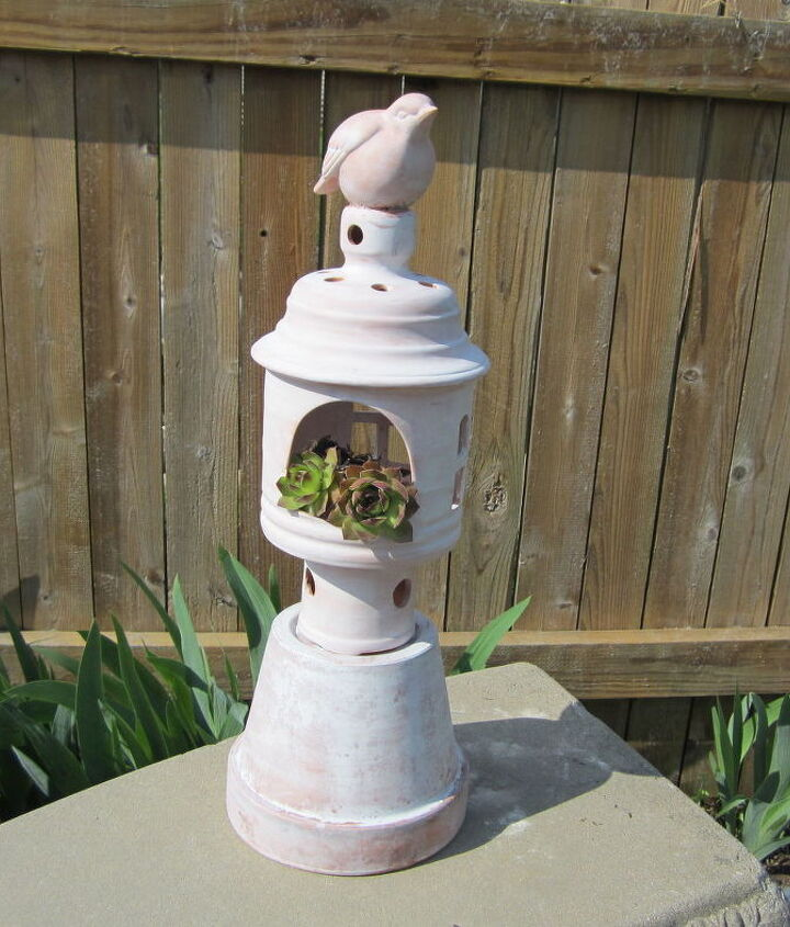 Using four separate Terra Cotta pieces I found at the local Good Will and some silicone glue to start, I assembled and white washed. Thought I would use it in the garden with Hens and Chicks, but I wasn't thrilled with the result.