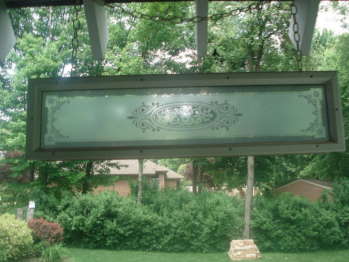 I found this at a Good will store an old door panel. I screw hooks in it and turn it side ways and hung it up on my porch.