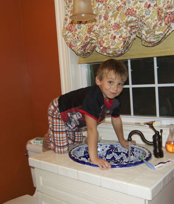 "My boy getting himself a drink in the ""old bathroom"""