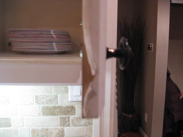 How do you paint laminate kitchen cupboards when they're ...