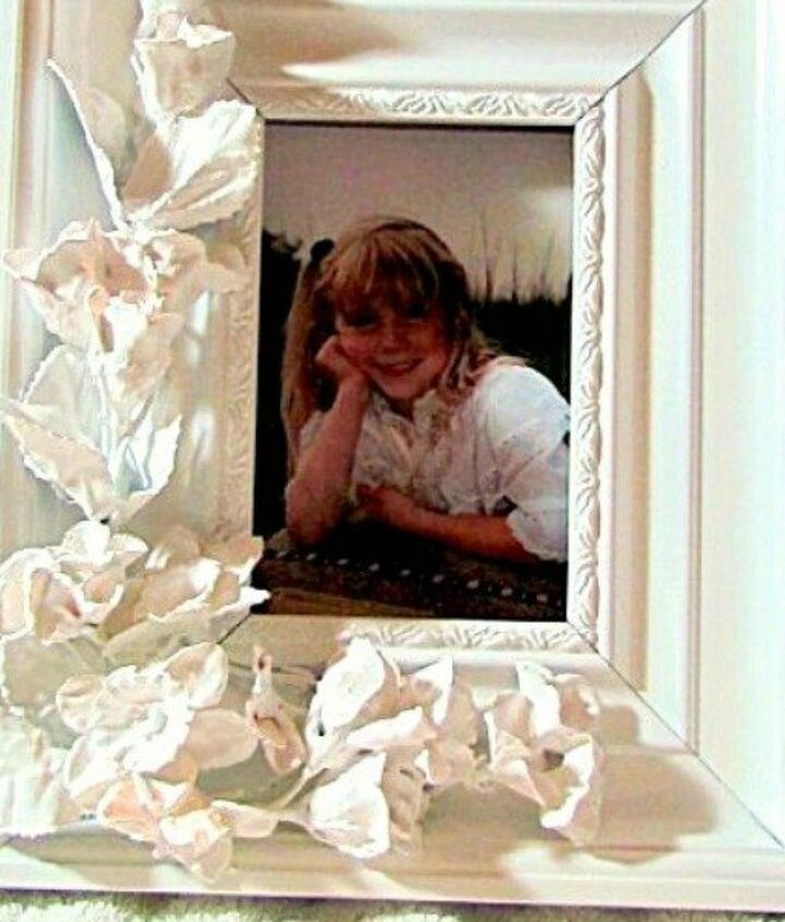s 23 awesome things you didn t know you could do with old picture frames, crafts, repurposing upcycling, Add artificial flowers for a porcelain look