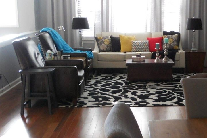 """Black stool beside recliner is the """"before"""" ."""