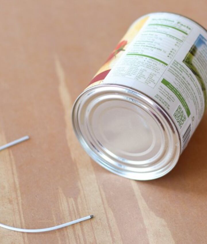 Supplies: a recycled tin can & a wire hanger