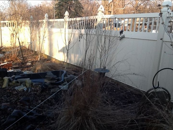 q leaning vinyl fence help, fences, home maintenance repairs, major home repair, As you might be able to see we tried using rope and stakes to pull it back Not working