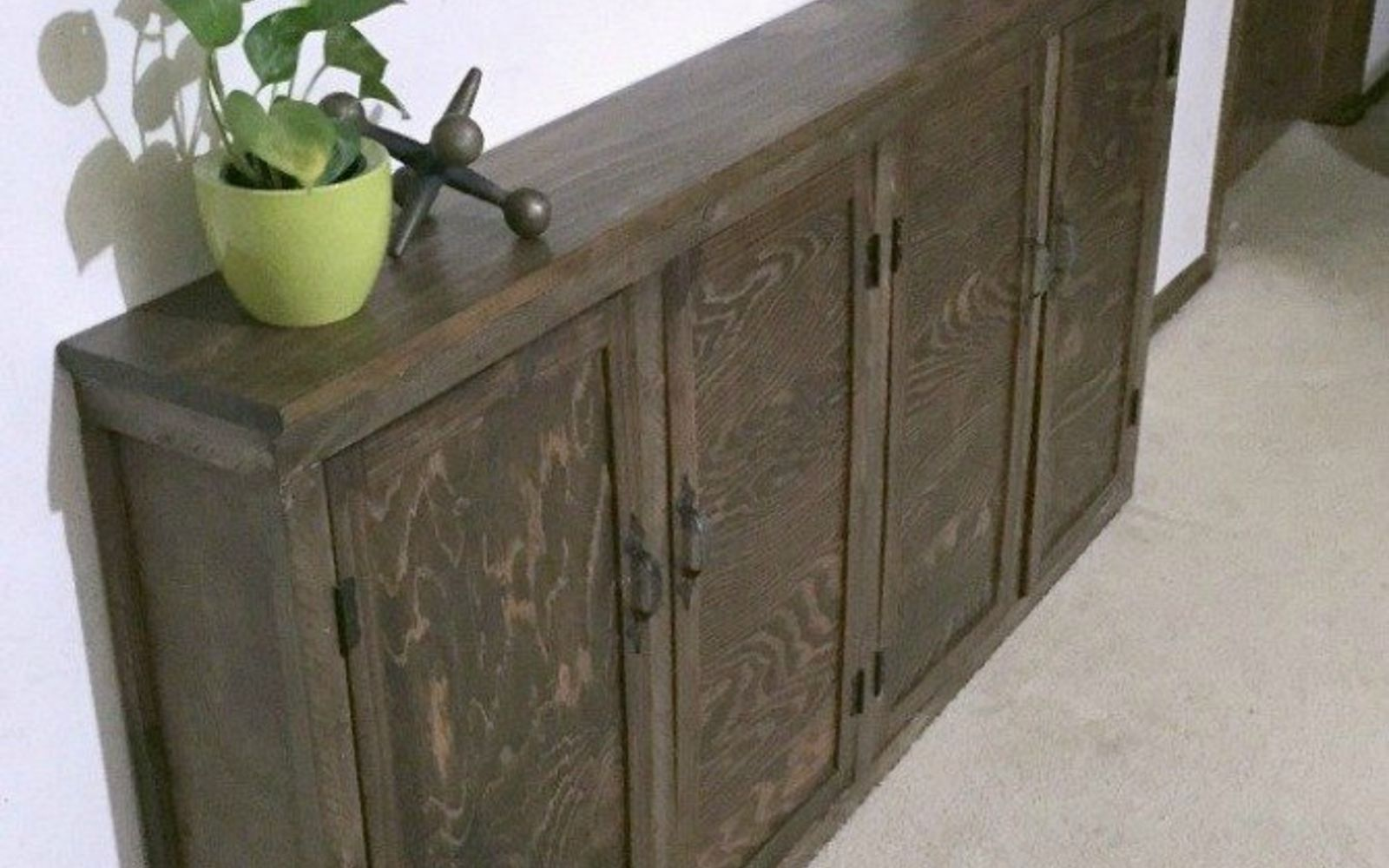 s 9 incredible organizing ideas we wish we d seen sooner, organizing, repurposing upcycling, Her sleek upcycled console cabinet