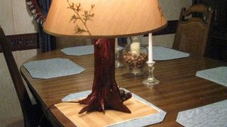 , This is another photo of a Lamp already posted I call it the Living Lamp Easy to make I cut the wood from an Old downed Cedar tree It s actually the Base of the tree with root system Clean it Bore Hole for Wiring Apply Poly