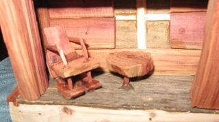 , Exterior of Cabin storage box with Tiny Hand Carved Chair Table Photo 4