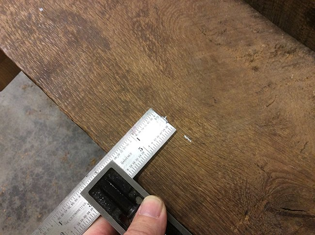 Mark location for knobs with a ruler/square.