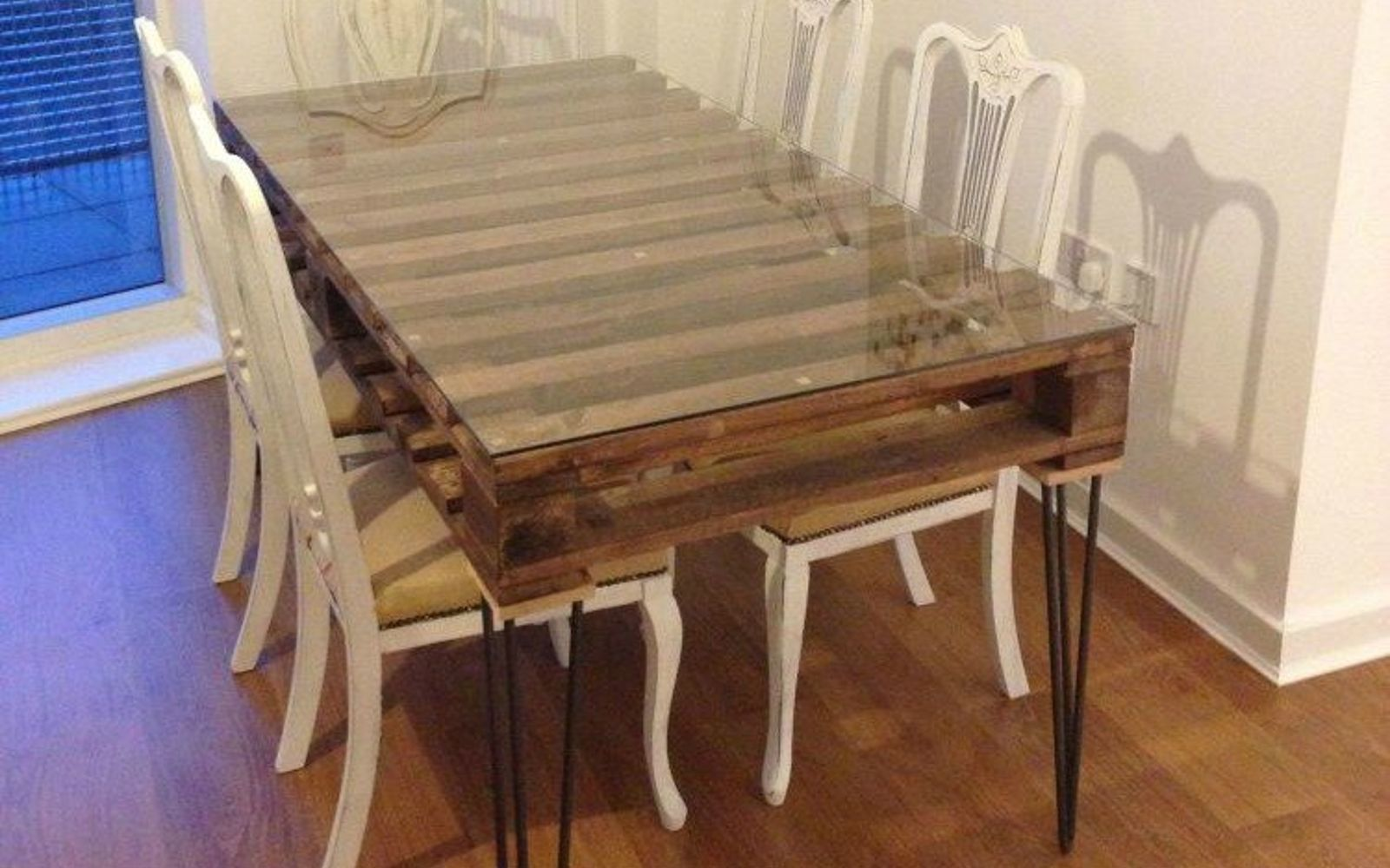 s 18 incredibly easy ways to use the entire pallet, pallet, Add legs to make a dining table with storage