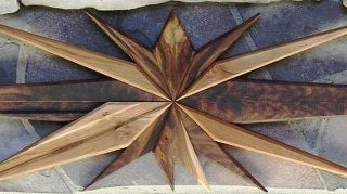 , The redwood garden stars led to a request for a fireplace mantel decoration of carved walnut and cherry