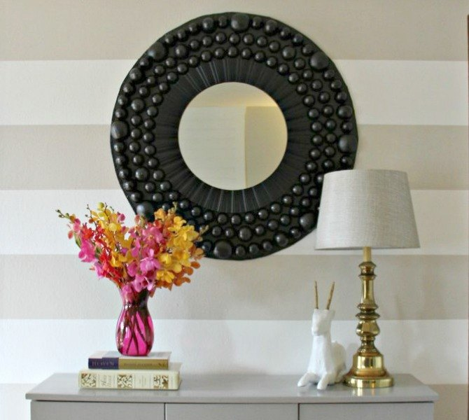 s 13 inexpensive entryway ideas that will make you smile every time you, crafts, foyer, Turn leftover Easter eggs into a bold mirror