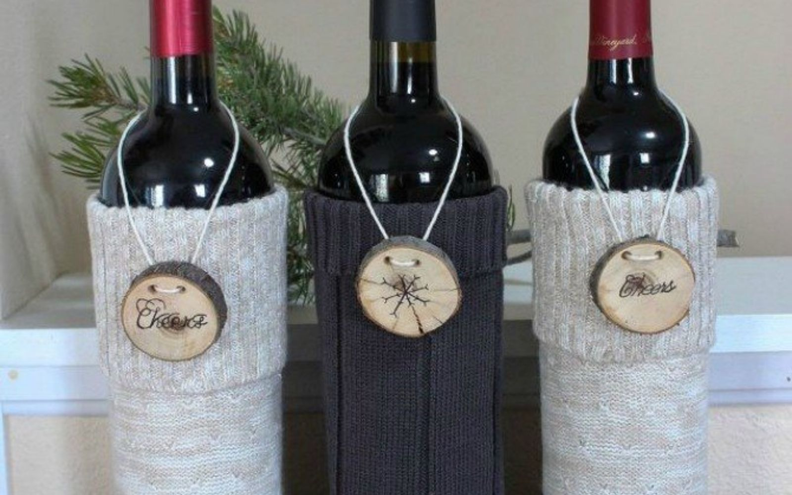 s 15 reasons not to trash your ugly worn out sweaters, crafts, repurposing upcycling, Make a set of wine covers for hostess gifts
