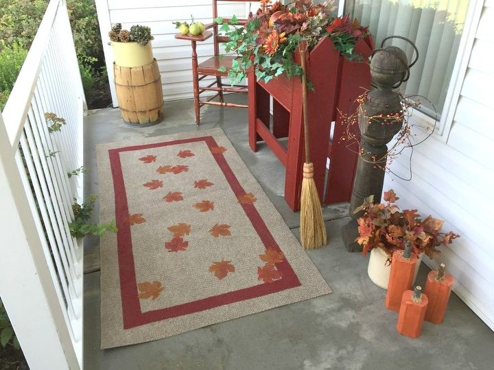 s 13 expensive looking outdoor rug ideas that cost less than 20, flooring, outdoor living, reupholster, Stencil a playful graphic with craft paint