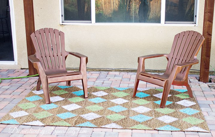 s 13 expensive looking outdoor rug ideas that cost less than 20, flooring, outdoor living, reupholster, Update last year s worn rug with a pattern