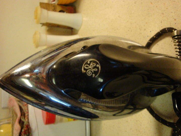 q cleaning iron plate, cleaning tips, house cleaning, tools, Older GE logo Notice the black white cloth cord