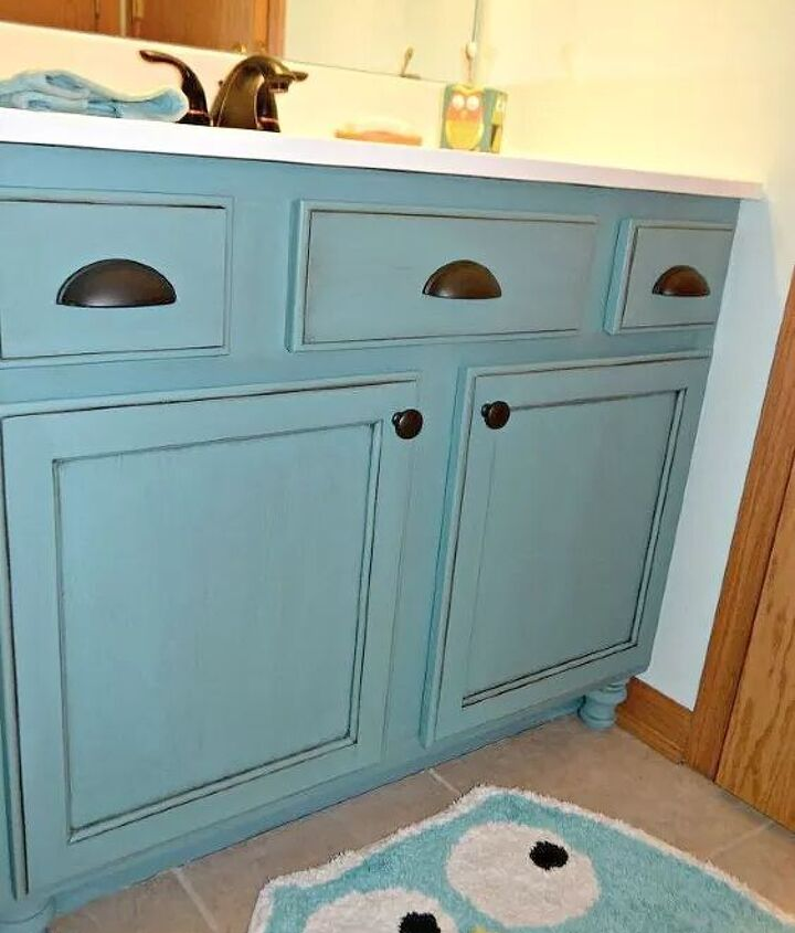 s 11 low cost ways to replace or redo a hideous bathroom vanity, bathroom ideas, painted furniture, plumbing, Add new hardware feet to your old vanity