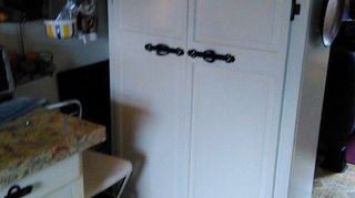 , DIY pantry made from an old bookcase added bun feet for finished look