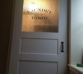 The Finishing TouchA Sliding Barn Door for the Laundry Room