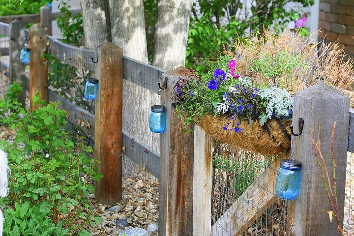 s 13 spectacular things to make for your yard using 1 solar lights, lighting, outdoor living, repurposing upcycling, These glassy blue fence lights