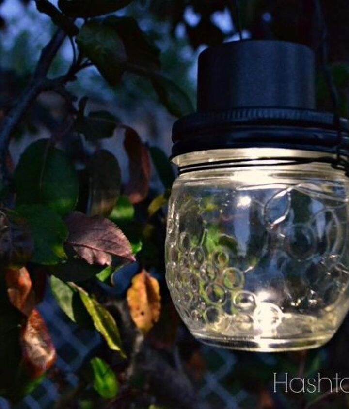 s 13 spectacular things to make for your yard using 1 solar lights, lighting, outdoor living, repurposing upcycling, Some simple luminaries to hang in your trees