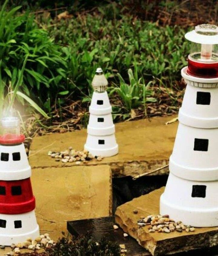 s 13 spectacular things to make for your yard using 1 solar lights, lighting, outdoor living, repurposing upcycling, These adorable terra cotta lighthouses