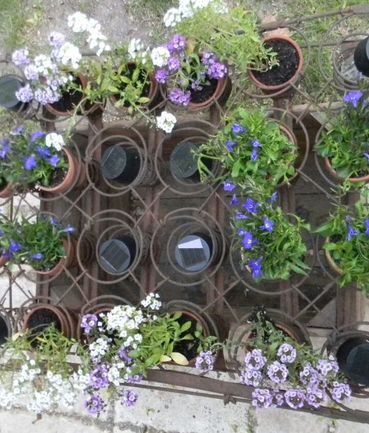 s 13 spectacular things to make for your yard using 1 solar lights, lighting, outdoor living, repurposing upcycling, This illuminated flower bed from bed springs