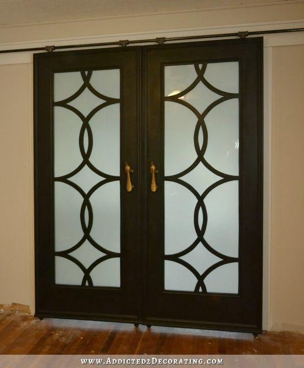 s 12 clever tricks to turn builder grade doors into custom made beauties, doors, Cut out the center and replace it with glass