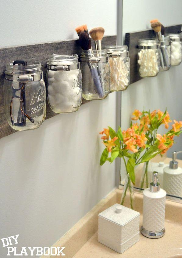 s 13 tricks people who hate bathroom clutter swear by, bathroom ideas, organizing, Make a mason jar organizer for the wall