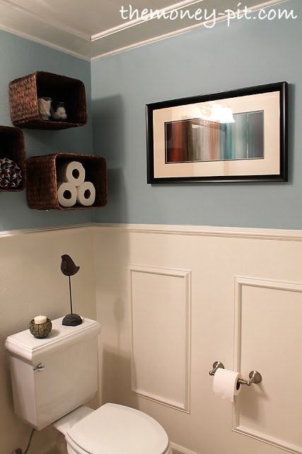 s 13 tricks people who hate bathroom clutter swear by, bathroom ideas, organizing, Get easy shelves by putting baskets on a wall