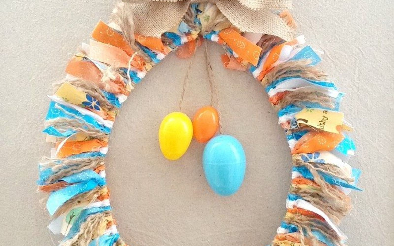 s 31 gorgeous spring wreaths that will make your neighbors smile, crafts, seasonal holiday decor, wreaths, Tie fabric scraps along a hanger