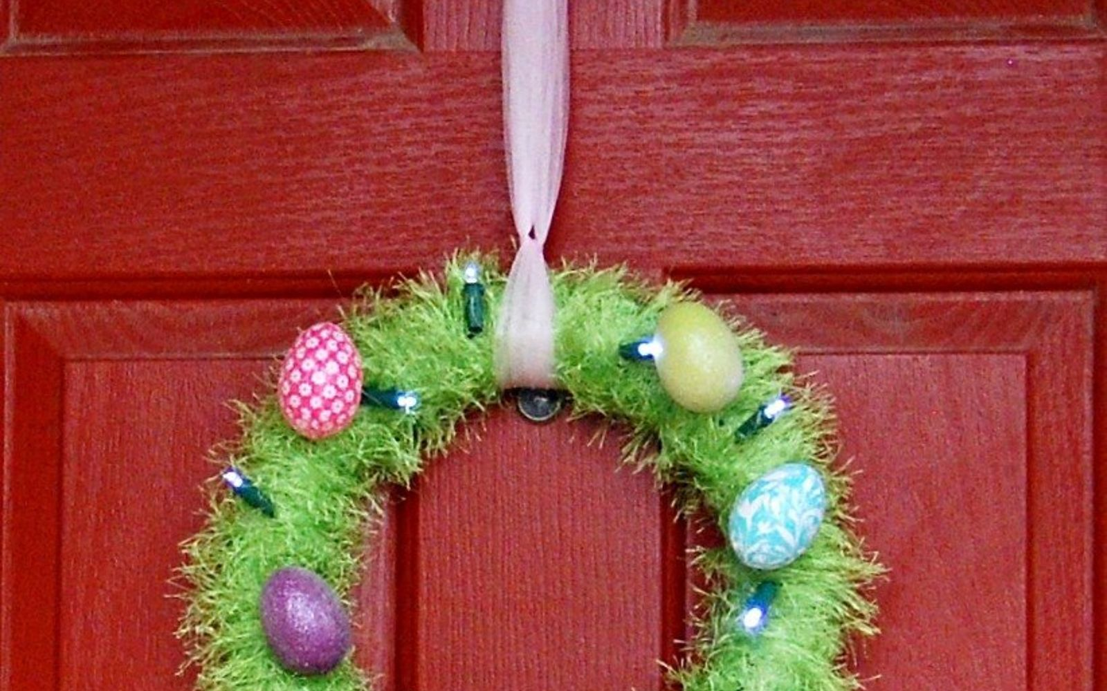 s 31 gorgeous spring wreaths that will make your neighbors smile, crafts, seasonal holiday decor, wreaths, Wrap lights around a grassy wreath