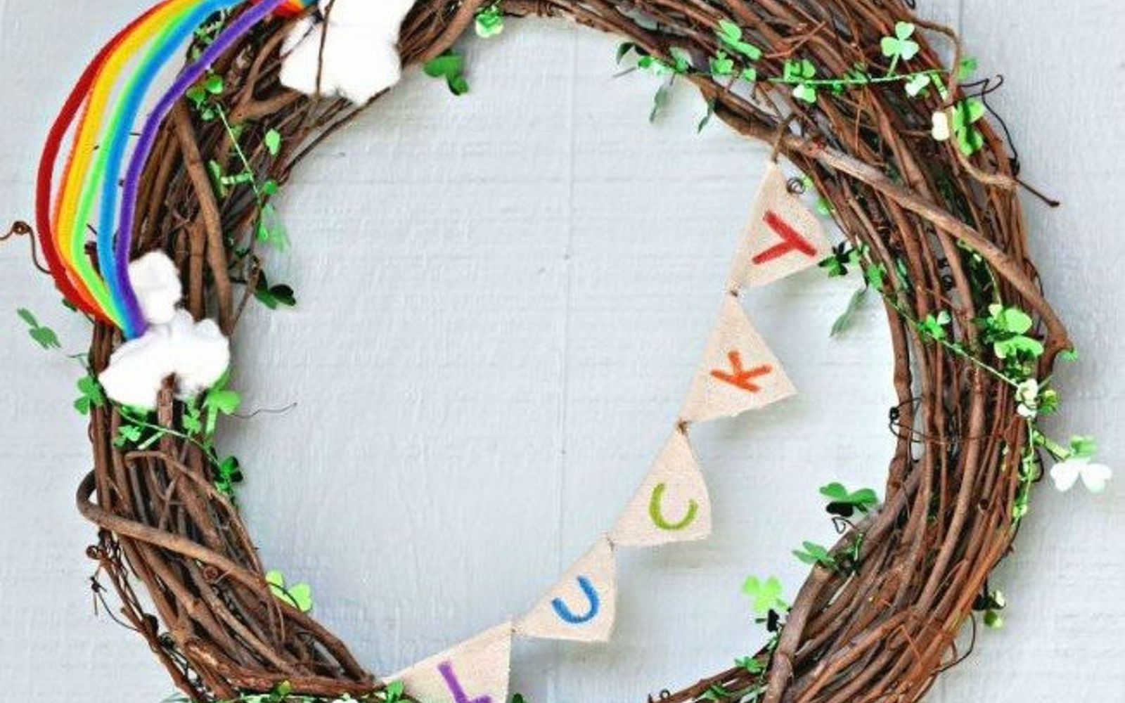 s 31 gorgeous spring wreaths that will make your neighbors smile, crafts, seasonal holiday decor, wreaths, Create a clover filled grapevine wreath