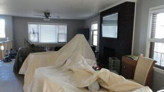 q need help with huge ugly fireplace, fireplaces mantels, home decor, home decor dilemma, Attempt 1 I don t have a pic of the orange brick but here is where we stained it black This pic is in the process of remodeling which is why things are covered up I liked the black but it still took over the room