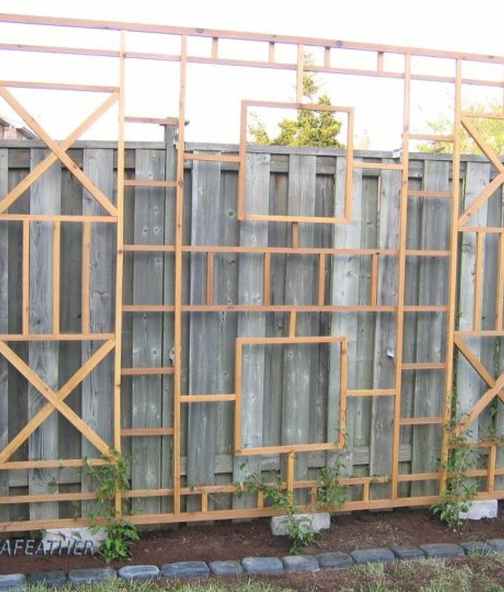 s 15 privacy fences that will turn your yard into a secluded oasis, curb appeal, fences, Build an intricate frame for a flowering vine