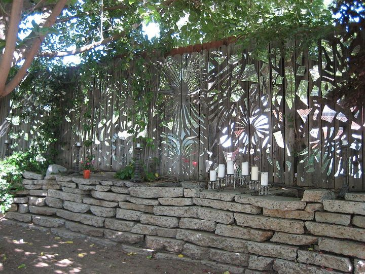 s 15 privacy fences that will turn your yard into a secluded oasis, curb appeal, fences, Make a shimmering mosaic from mirror shards