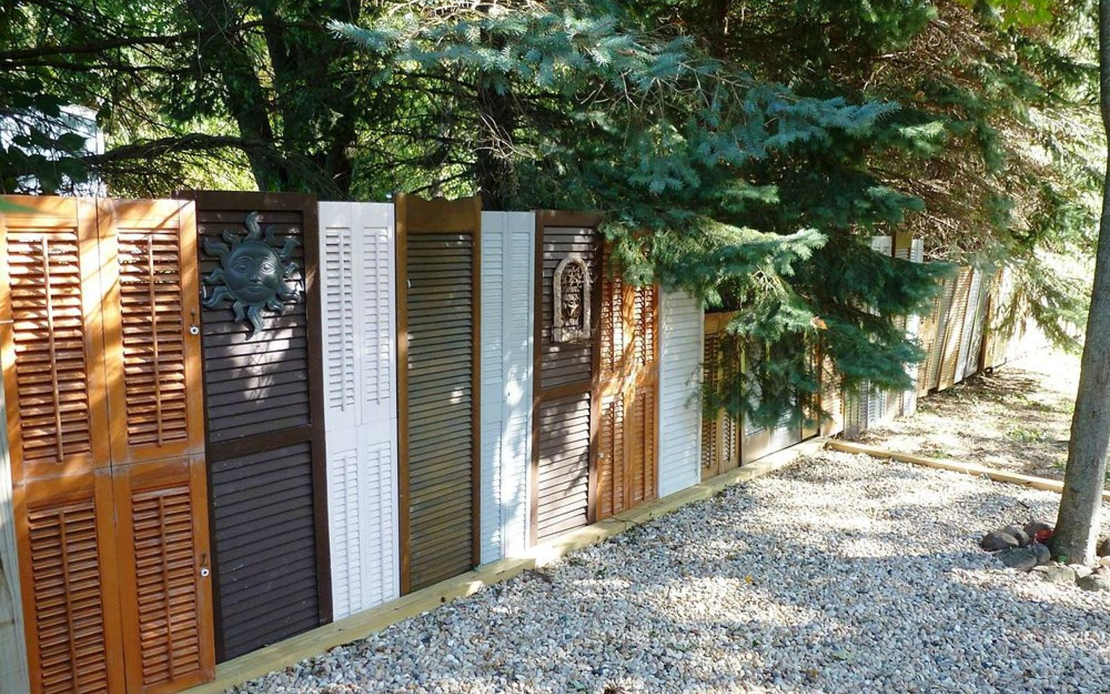 s 15 privacy fences that will turn your yard into a secluded oasis, curb appeal, fences, Or line up a mix of old shutters