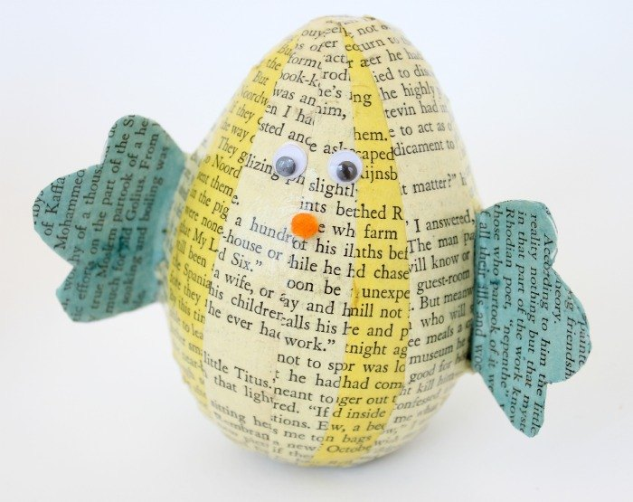 s 25 quick easter egg ideas that are just too stinkin cute, crafts, easter decorations, Wrap eggs in book pages craft chicks