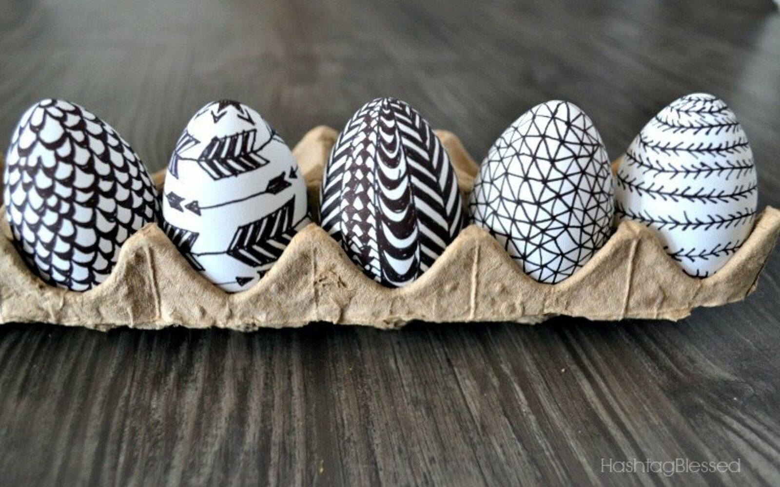 s 25 quick easter egg ideas that are just too stinkin cute, crafts, easter decorations, Doodle on a couple eggs with Sharpies