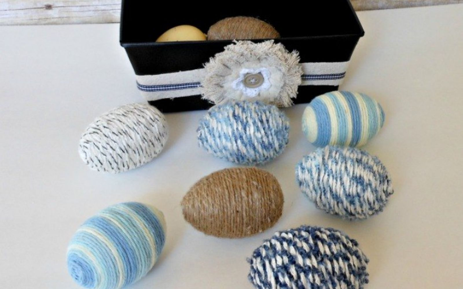 s 25 quick easter egg ideas that are just too stinkin cute, crafts, easter decorations, Craft a mix of textures with colorful yarn