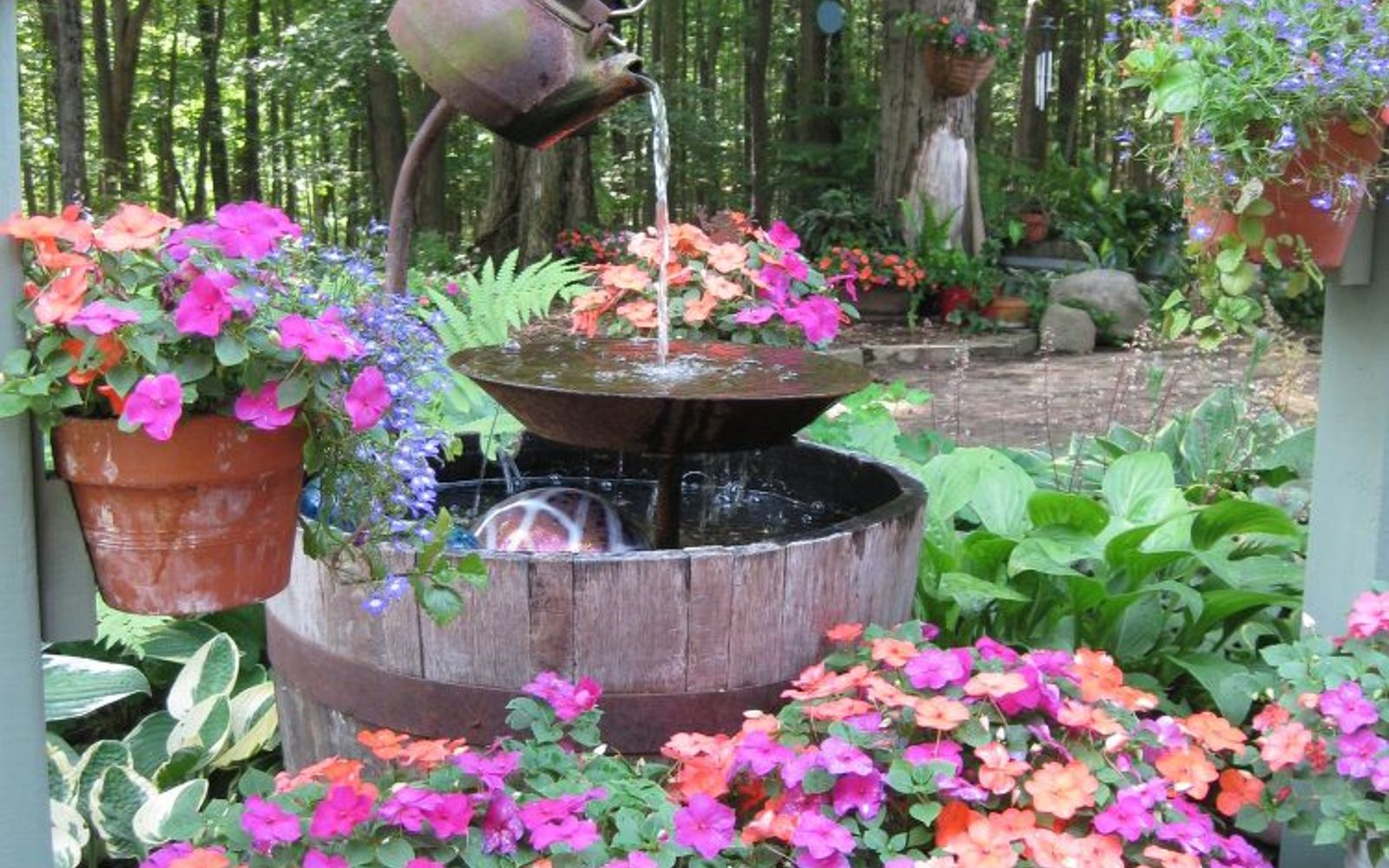 s 10 mini water features to add zen to your garden, outdoor living, ponds water features, Upcycle a teapot into a rustic fountain