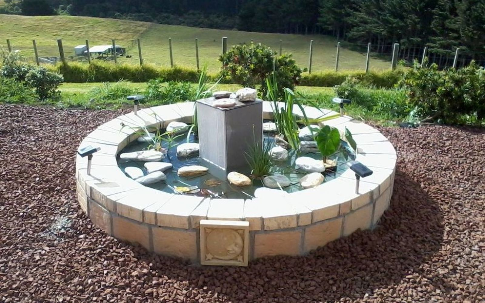 s 10 mini water features to add zen to your garden, outdoor living, ponds water features, Flip an old hot tub into a plant pond