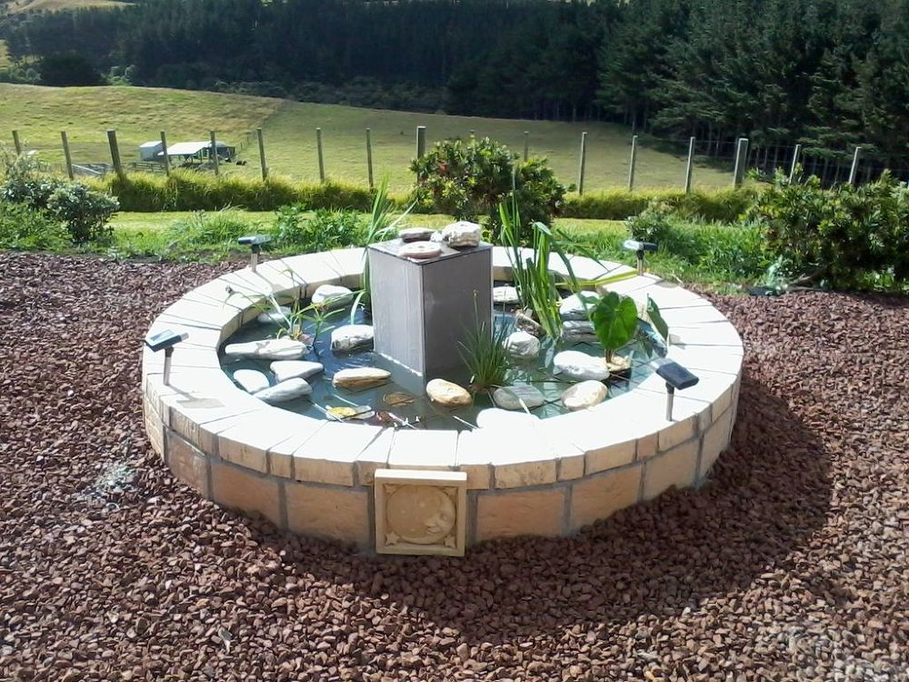 10 mini water features to add zen to your garden hometalk for Outdoor pond
