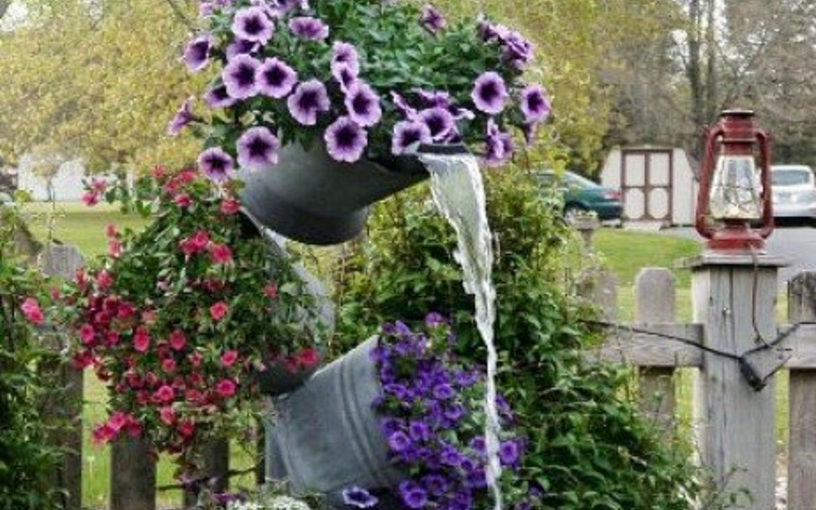 s 10 mini water features to add zen to your garden, outdoor living, ponds water features, Stack flower filled buckets into a tower
