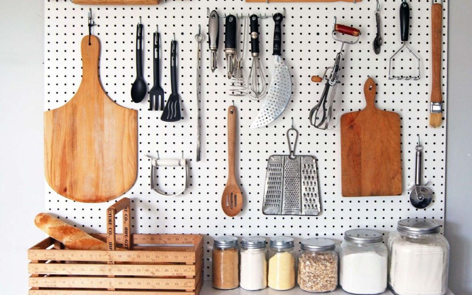 s 15 ways to organize every messy nook with pegboard, organizing, woodworking projects, Get perfect kitchen utensil organization