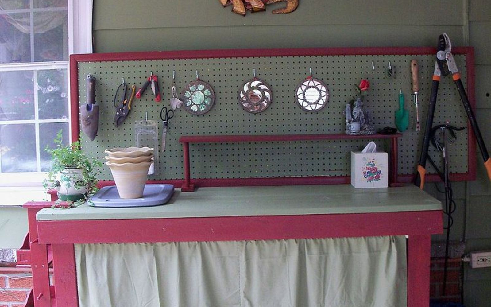 s 15 ways to organize every messy nook with pegboard, organizing, woodworking projects, Add to your potting bench for garden storage