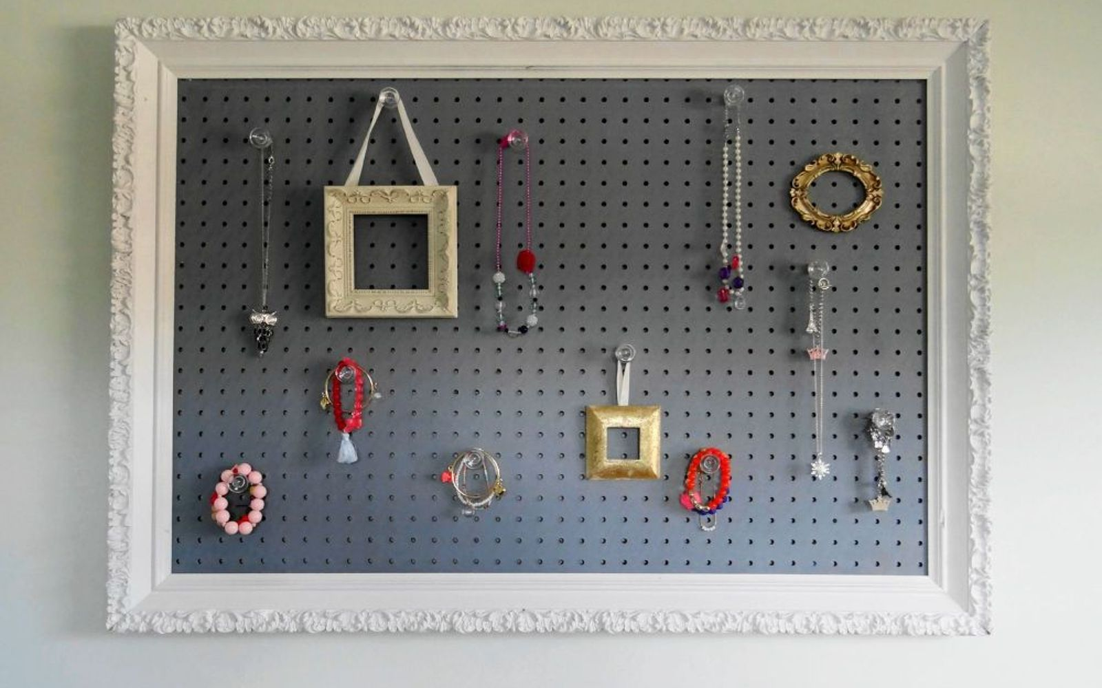 s 15 ways to organize every messy nook with pegboard, organizing, woodworking projects, Frame a board on the wall to hold jewelry
